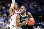 Vanderbilt's Isaiah Rice (14) drives against Arkansas guard Jalen Harris in the first half of an NCAA college basketball game in the Southeastern Conference Tournament Wednesday, March 11, 2020, in Nashville, Tenn. (AP Photo/Mark Humphrey)