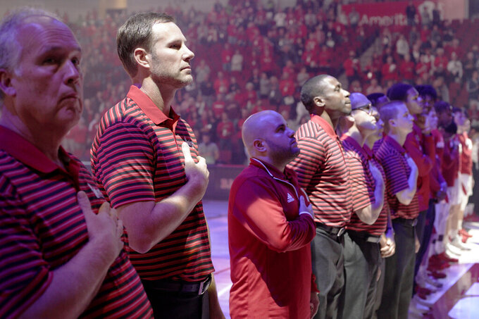 In this Wednesday, Oct. 30, 2019 photo, Nebraska head coach Fred Hoiberg, second left, stands with staff and players before an NCAA college basketball exhibition game against Doane University in Lincoln, Neb. Hoiberg knows the track record of Nebraska basketball coaches is not good. He wanted the job anyway. He takes over a program that has not won a conference championship in 70 years or ever won a game in the NCAA Tournament. He says a sold-out arena and top-notch facilities can trump the program's lack of tradition. (AP Photo/Nati Harnik)