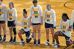 Drexel players stand and kneel while the National Anthem is played before the start of the first half of a college basketball game against Georgia in the first round of the women's NCAA tournament at the Greehey Arena in San Antonio, Texas, Monday, March 22, 2021. (AP Photo/Ronald Cortes)