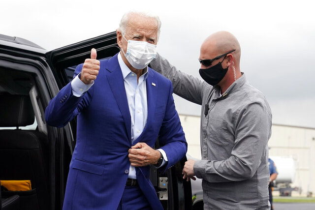 Democratic presidential candidate former Vice President Joe Biden arrives to board a plane at New Castle Airport in New Castle, Del., Wednesday, Sept. 9, 2020, en route to campaign events in Michigan. (AP Photo/Patrick Semansky)
