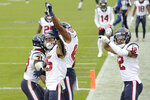 Houston Texans wide receiver Will Fuller (15) celebrates with teammates after catching a touchdown pass against the Tennessee Titans in the second half of an NFL football game Sunday, Oct. 18, 2020, in Nashville, Tenn. (AP Photo/Mark Zaleski)