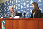 Catie Griggs, right, is introduced as the Seattle Mariners' new president of business operations by John Stanton, the team's chairman and managing partner, during a baseball a press conference on Wednesday, July 28, 2021, (AP Photo/Jason Redmond)