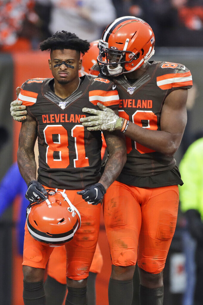 Cleveland Browns tight end Demetrius Harris (88) congratulates wide receiver Rashard Higgins (81) after Higgins scored a 7-yard touchdown during the second half of an NFL football game, Sunday, Nov. 10, 2019, in Cleveland. (AP Photo/Ron Schwane)