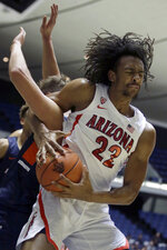 Arizona forward Zeke Nnaji, right, pulls down a rebound and is fouled by Pepperdine forward Jan Zidek during the first half of an NCAA college basketball game at the Wooden Legacy tournament in Anaheim, Calif., Thursday, Nov. 28, 2019. (AP Photo/Alex Gallardo)