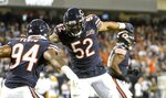 Chicago Bears' Leonard Floyd is congratulated by Khalil Mack after sacking Green Bay Packers' Aaron Rodgers during the first half of an NFL football game Thursday, Sept. 5, 2019, in Chicago. (AP Photo/David Banks)