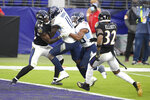 Tennessee Titans wide receiver A.J. Brown (11) gets help from teammate running back Jeremy McNichols, center right, while scoring against Baltimore Ravens inside linebacker Patrick Queen (48) and free safety DeShon Elliott (32) during the second half of an NFL football game, Sunday, Nov. 22, 2020, in Baltimore. (AP Photo/Nick Wass)