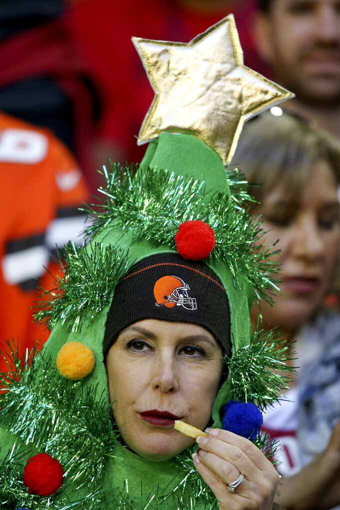 Cleveland Browns fans watches during the first half of an NFL football game against the Arizona Cardinals, Sunday, Dec. 15, 2019, in Glendale, Ariz. (AP Photo/Ross D. Franklin)