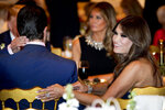 Kimberly Guilfoyle, right, and Donald Trump Jr., the son of President Donald Trump, left, sit with President Donald Trump, background left, and first lady Melania Trump, center, during Christmas Eve dinner at Mar-a-lago in Palm Beach, Fla., Tuesday, Dec. 24, 2019. (AP Photo/Andrew Harnik)