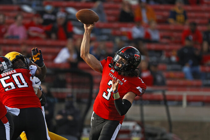 Texas Tech's Henry Colombi (3) passes the ball during the first half of an NCAA football game against West Virginia, Saturday, Oct. 24, 2020, in Lubbock, Texas. (AP Photo/Brad Tollefson)