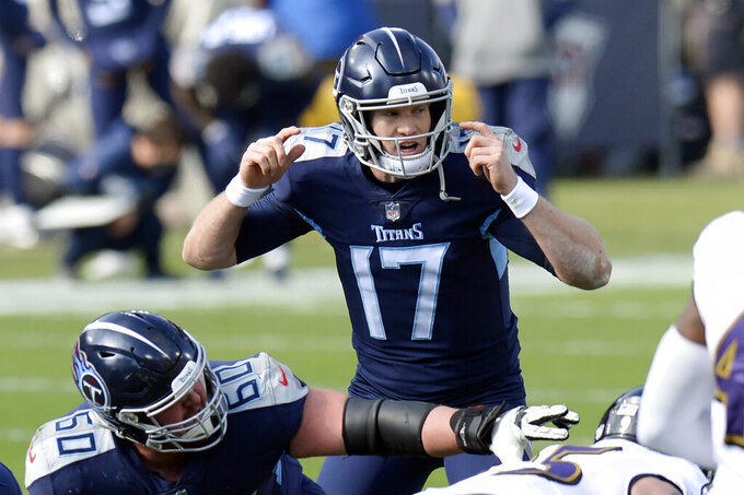 Tennessee Titans quarterback Ryan Tannehill (17) calls a play in the first half of an NFL wild-card playoff football game against the Baltimore Ravens Sunday, Jan. 10, 2021, in Nashville, Tenn. (AP Photo/Mark Zaleski)