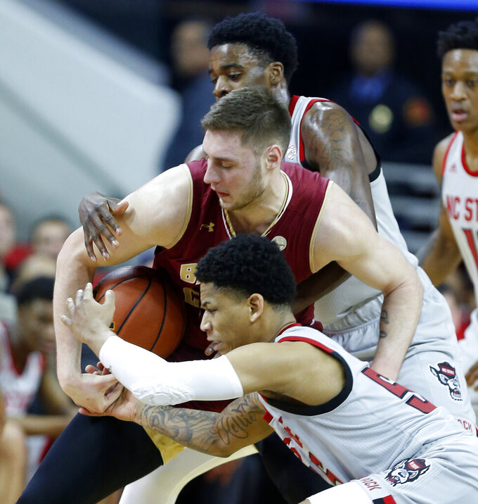 North Carolina State's Blake Harris, front, and DJ Funderburk pressure Boston College's Nik Popovic during the first half of an NCAA college basketball game in Raleigh, N.C., Wednesday, Feb. 20, 2019. (Ethan Hyman/The News & Observer via AP)