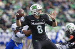 FILE - Marshall quarterback Grant Wells (8) throws a pass against Middle Tennessee during an NCAA college football game in Huntington, W.Va., in this Saturday, Nov. 14, 2020, file photo. Rice and No. 15 Marshall meet on Saturday, Dec. 5 in a game that was postponed from Oct. 3. (Sholten Singer/The Herald-Dispatch via AP, File)
