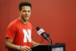 Nebraska quarterback Adrian Martinez talks during a news conference in Lincoln, Neb., Monday, Aug. 26, 2019. No. 24 Nebraska is in the preseason Top 25 for the first time since 2014, and a big reason for the positive vibe is Martinez, who last season was the most productive freshman quarterback in the nation. (AP Photo/Nati Harnik)