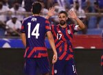 United States' Sebastian Lletget, right, celebrates with his teammate Ricardo Pepi after scoring his side's fourth goal against Honduras during a qualifying soccer match for the FIFA World Cup Qatar 2022, in San Pedro Sula, Honduras, Wednesday, Sept. 8, 2021. (AP Photo/Moises Castillo)