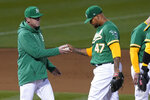 Oakland Athletics pitcher Frankie Montas (47) hands the ball to manager Bob Melvin as he is taken out for a relief pitcher during the seventh inning of a baseball game against the Kansas City Royals in Oakland, Calif., Thursday, June 10, 2021. (AP Photo/Jeff Chiu)
