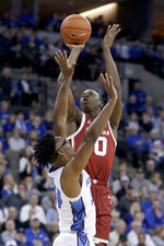 Oklahoma's Victor Iwuakor (0) shoots over Creighton's Denzel Mahoney (34) during the first half of an NCAA college basketball game in Omaha, Neb., Tuesday, Dec. 17, 2019. (AP Photo/Nati Harnik)