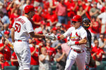 St. Louis Cardinals' Tommy Edman, right, is congratulated by teammate Adam Wainwright (50) after hitting a solo home run during the third inning of a baseball game against the Washington Nationals Wednesday, Sept. 18, 2019, in St. Louis. (AP Photo/Jeff Roberson)
