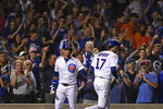 Chicago Cubs' Kris Bryant (17) celebrates with Javier Baez left, after hitting a two-run home run during the eighth inning of the team's baseball game against the San Francisco Giants on Wednesday, Aug 21, 2019, in Chicago. Chicago won 12-11. (AP Photo/Paul Beaty)