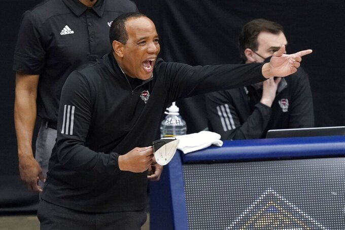 North Carolina State head coach Kevin Keatts instructs his team in the second half of an NCAA college basketball game against Colorado State in the quarterfinals of the NIT, Thursday, March 25, 2021, in Frisco, Texas. (AP Photo/Tony Gutierrez)