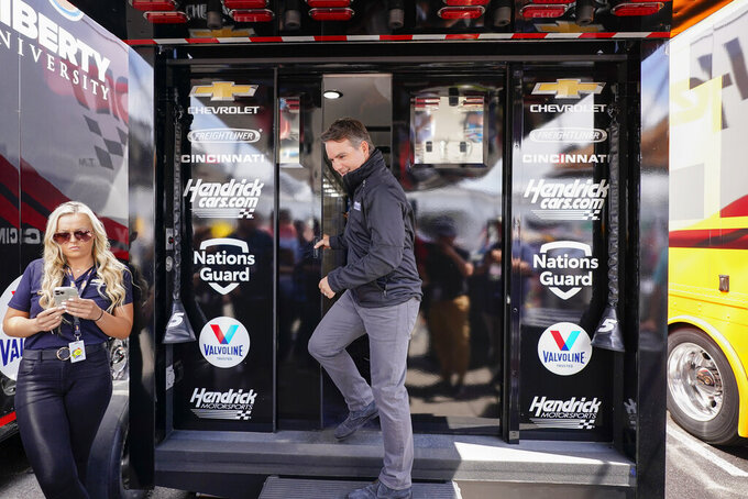 Former Nascar driver Jeff Gordon exits a Hendrick Motorsports trailer to speak at a news conference before the scheduled races at Pocono Raceway, Sunday, June 27, 2021, in Long Pond, Pa. It was announced Wednesday that Gordon was leaving the Fox Sports broadcast booth to become vice chairman at Hendrick Motorsports. (AP Photo/Matt Slocum)