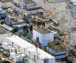 FILE - This Sept. 4, 2017, aerial file photo shows Fukushima Dai-ichi nuclear power plant's reactors, from bottom at right, Unit 1, Unit 2 and Unit 3, in Okuma, Fukushima prefecture, northeastern Japan. Japan revised a roadmap on Friday, Dec. 27, 2019, for the tsunami-wrecked Fukushima nuclear plant cleanup, further delaying the removal of thousands of spent fuel units that remain in cooling pools since the 2011 disaster. It's a key step in the decadeslong process, underscoring high radiation and other risks. (Daisuke Suzuki/Kyodo News via AP, File)/Kyodo News via AP)