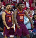 Virginia Tech's Brendan Palmer (11) and Jonathan Kabongo (10) react to a play during the second half of an NCAA college basketball game against North Carolina State in Raleigh, N.C., Saturday, Feb. 2, 2019. (AP Photo/Ben McKeown)