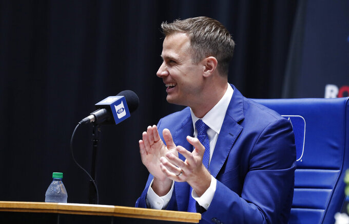 Jon Scheyer applauds people in the crowd after being introduced during an NCAA college basketball press conference at Cameron Indoor Stadium in Durham, N.C., Friday, June 4, 2021. Scheyer will spend the upcoming year in his role as associate head coach as coach Mike Krzyzewski chases one more championship in a Hall of Fame career. Then it's up to the 33-year-old Scheyer to take over ahead of the 2022-23 season in the program's first coaching change in more than four decades. (Ethan Hyman/The News & Observer via AP)