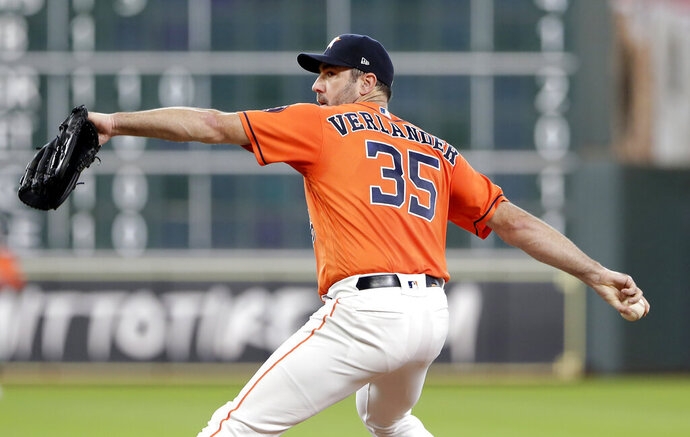 Houston Astros starting pitcher Justin Verlander throws during the first inning of the team's baseball game against the Texas Rangers on Friday, July 19, 2019, in Houston. (AP Photo/Michael Wyke)
