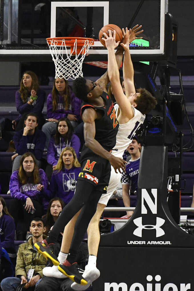 Maryland forward Jalen Smith (25) fouls Northwestern center Ryan Young (15) during the first half of an NCAA college basketball game, Tuesday, Jan. 21, 2020, in Evanston, Ill. (AP Photo/David Banks)