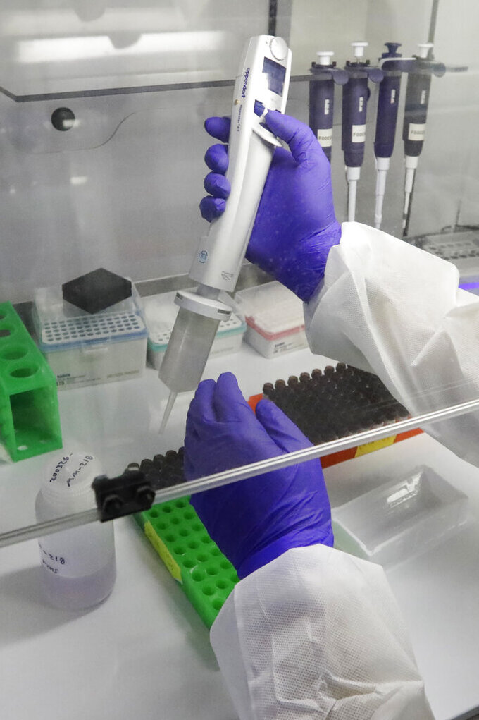 A Co-Diagnostics lab technician manufactures COVID-19 testing kits Friday, March 27, 2020, in Salt Lake City. The company says it has the capacity to produce 50,000 test kits daily from its Salt Lake City facility. (AP Photo/Rick Bowmer)