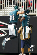 Philadelphia Eagles wide receiver DeVonta Smith (6) celebrates his touchdown catch with Philadelphia Eagles tight end Zach Ertz (86) during the first half of an NFL football game against the Atlanta Falcons, Sunday, Sept. 12, 2021, in Atlanta. (AP Photo/Brynn Anderson)