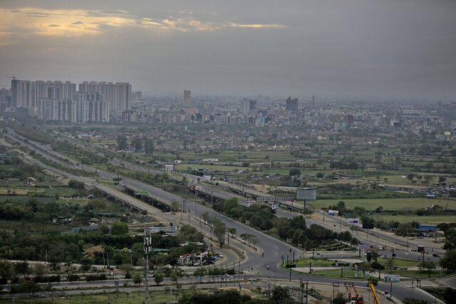 Roads are seen deserted during a lockdown in Greater Noida, a suburb of New Delhi, India, Thursday, March 26, 2020. Some of India's legions of poor and people suddenly thrown out of work by a nationwide stay-at-home order began receiving aid distribution Thursday, as both the public and private sector work to blunt the impact of efforts to curb the coronavirus pandemic. Untold numbers of them are now out of work and many families have been left struggling to eat. (AP Photo/Altaf Qadri)