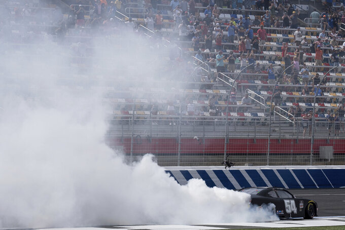 Ty Gibbs does a celebratory burnout after winning the Alsco Uniforms 300 NASCAR Xfinity Series auto race at Charlotte Motor Speedway on Saturday, May 29, 2021 in Charlotte, NC. (AP Photo/Ben Gray)