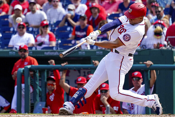 Washington Nationals' Juan Soto hits a solo home run during the third inning of a baseball game against the Colorado Rockies at Nationals Park, Sunday, Sept. 19, 2021, in Washington. (AP Photo/Andrew Harnik)