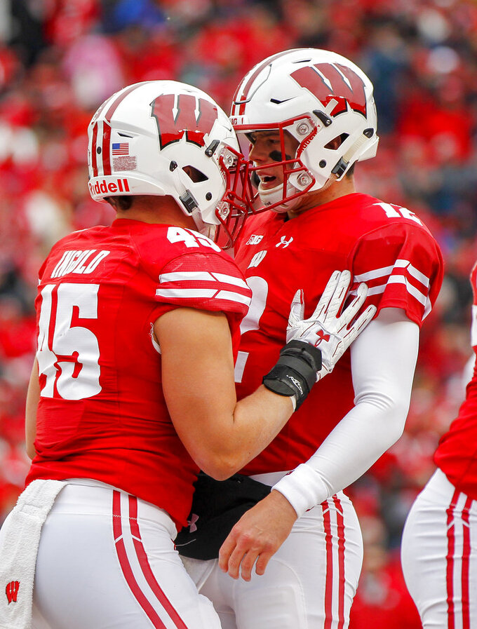 Wisconsin fullback Alec Ingold, left, and Alex Hornibrook celebrate Ingold's touchdown against Illinois during the first half of an NCAA college football game Saturday, Oct. 20, 2018, in Madison, Wis. (AP Photo/Andy Manis)