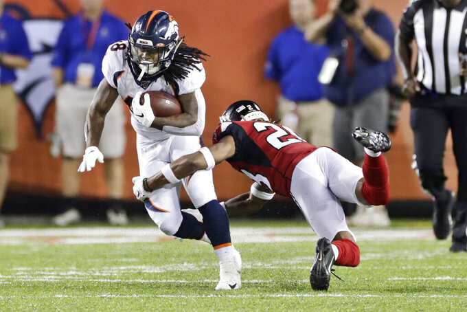 Denver Broncos running back Devontae Jackson (48) breaks a tackle from Atlanta Falcons defensive back Jordan Miller (28) during the second half of the Pro Football Hall of Fame NFL preseason game Thursday, Aug. 1, 2019, in Canton, Ohio. (AP Photo/Ron Schwane)