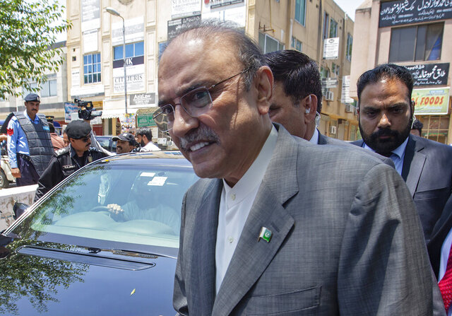 FILE - In this June 10, 2019 file photo, former Pakistani President Asif Ali Zardari leaves the High Court building, in Islamabad, Pakistan. On Monday, Oct. 5, 2020, a Pakistani court charged Zardari in two corruption cases, escalating the legal challenges facing the now leading opposition lawmaker and widower of assassinated former Pakistani Prime Minister Benazir Bhutto. The development came as Zardari's party and a key anti-government ally were preparing for a massive rally against Prime Minister Imran Khan later this month. (AP Photo/B.K. Bangash, File)