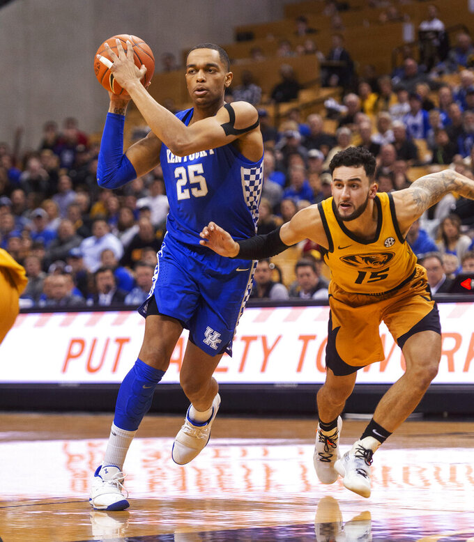 Kentucky's PJ Washington, left, drives toward the basket past Missouri's Jordan Geist during the first half of an NCAA college basketball game Tuesday, Feb. 19, 2019, in Columbia, Mo. Kentucky won 66-58. (AP Photo/L.G. Patterson)