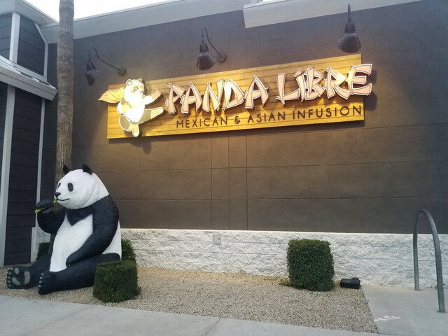 "Panda Libre, an Asian-Mexican fusion restaurant, in Gilbert, Ariz., is pictured on Thursday, Feb. 27, 2020. When picking a name for their Asian-Mexican fusion restaurant in suburban Phoenix, Paul and Nicole Fan settled on ""Panda Libre,"" hoping the mix of China's iconic bear and the Spanish word for ""free"