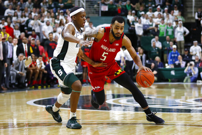 Maryland guard Eric Ayala (5) drives on Michigan State guard Cassius Winston (5) in the first half of an NCAA college basketball game in East Lansing, Mich., Saturday, Feb. 15, 2020. (AP Photo/Paul Sancya)