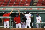 Boston Red Sox's Jackie Bradley Jr. (19) celebrates after scoring on a double by J.D. Martinez during the third inning of an opening day baseball game against the Baltimore Orioles at Fenway Park, Friday, July 24, 2020, in Boston. (AP Photo/Michael Dwyer)