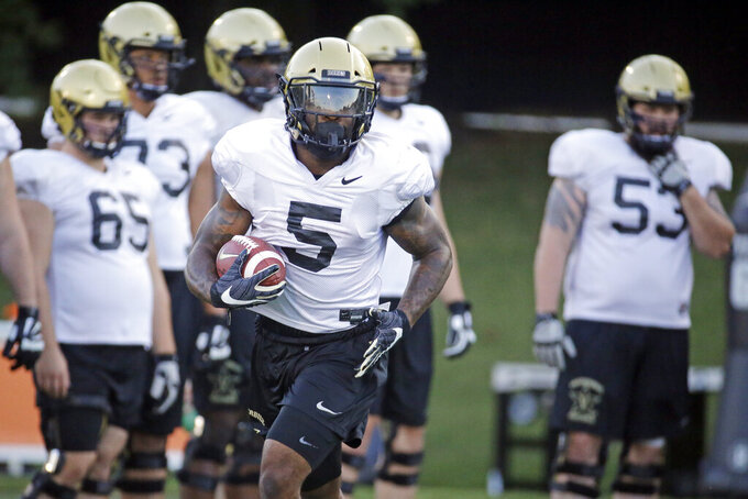 FILE - In this Aug. 5, 2019, file photo, Vanderbilt running back Ke'Shawn Vaughn (5) runs a drill during an NCAA college football practice in Nashville, Tenn. Vanderbilt is a 21-point home underdog and likely needs a big game from Vaughn to have any chance of staying competitive against the third-ranked Georgia on Saturday, Aug. 31. (AP Photo/Mark Humphrey, File)