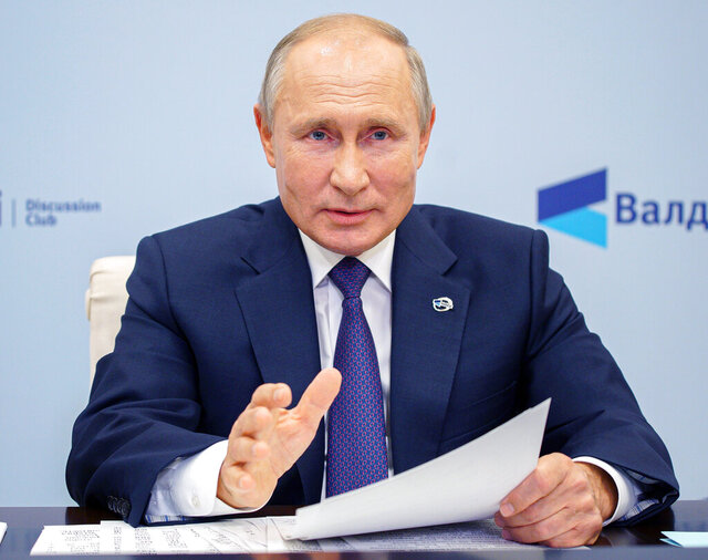 Russian President Vladimir Putin speaks as he participates in the annual meeting of the Valdai Discussion Club via video conference at the Novo-Ogaryovo residence outside Moscow, Russia, Thursday, Oct. 22, 2020. (Alexei Druzhinin, Sputnik, Kremlin Pool Photo via AP)