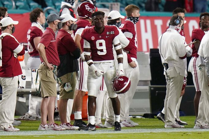 Alabama defensive back Jordan Battle reacts as he leaves the game after a targeting call against him during the first half of an NCAA College Football Playoff national championship game against Ohio State, Monday, Jan. 11, 2021, in Miami Gardens, Fla. (AP Photo/Chris O'Meara)