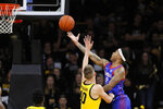 DePaul guard Devin Gage, right, shoots over Iowa guard Joe Wieskamp during the second half of an NCAA college basketball game, Monday, Nov. 11, 2019, in Iowa City, Iowa. DePaul won 93-78. (AP Photo/Charlie Neibergall)