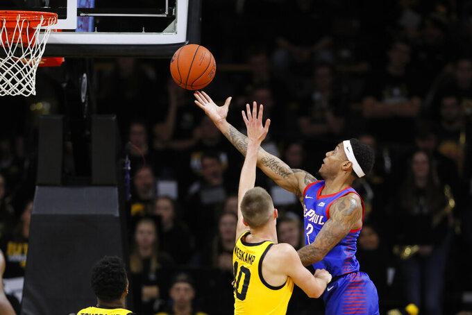 DePaul guard Devin Gage, right, shoots over Iowa guard Joe Wieskamp during the second half of an NCAA college basketball game, Monday, Nov. 11, 2019, in Iowa City, Iowa. DePaul won 93-78. (AP Photo/Charlie Neibergall)