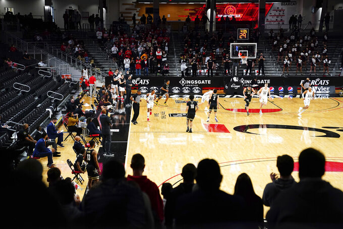 Fans watch the action between Vanderbilt and Cincinnati in the first half of an NCAA college basketball game Thursday, March 4, 2021, in Cincinnati. (Kareem Elgazzar/The Cincinnati Enquirer via AP)
