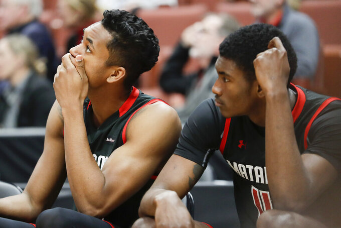 Cal State Northridge forward Jared Pearre, left, and Ron Artest III watch during their loss against UC Santa Barbara during an NCAA college basketball game at the Big West men's tournament in Anaheim, Calif., Thursday, March 14, 2019. (AP Photo/Chris Carlson)