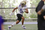 FILE - In this Aug. 5, 2019, file photo, Washington's Myles Bryant runs through a drill during an NCAA football practice in Seattle. Gone are four-year starting quarterback Jake Browning and his backfield mate Myles Gaskin, the school's all-time leading rusher. Gone are four starters from the secondary _ three selected in the NFL draft _ and the national leader in tackles in linebacker Ben Burr-Kirven. Myles Bryant is the one returning starter from the secondary, and is likely to play safety. (AP Photo/Elaine Thompson, File)