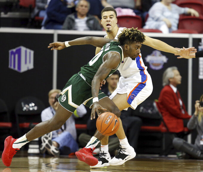 Colorado State's Kris Martin drives defended by Boise State's Alex Hobbs during the first half of an NCAA college basketball game in the Mountain West Conference tournament, Wednesday, March 13, 2019, in Las Vegas. (AP Photo/Isaac Brekken)